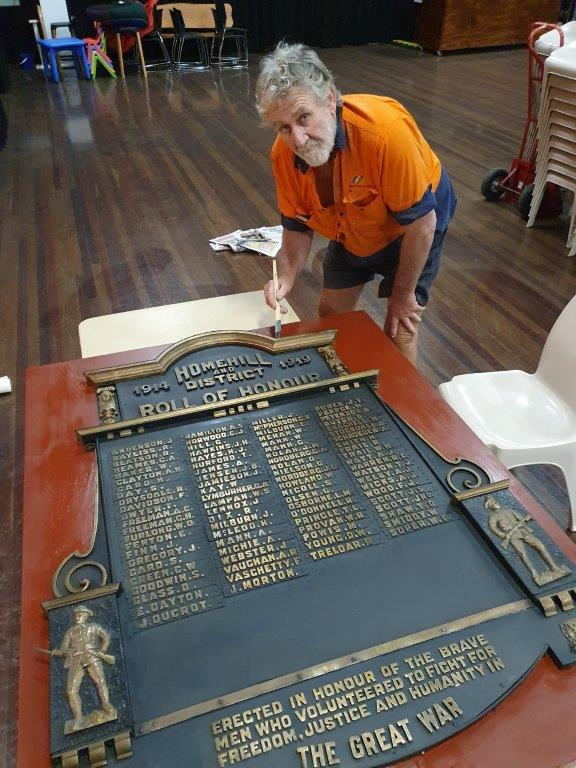 Wally Ford renovating memorial plaque